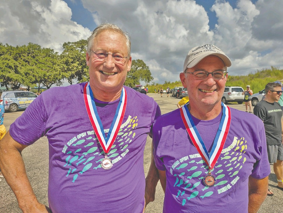 Swimmers Jeff Brown (left) and Aaron Kelson proudly don medals they won in September at the National Masters 5K Long-Distance Swimming Championships in Boerne, Texas. Kelson placed fifth in his age group and Brown placed sixth. Submitted photo.